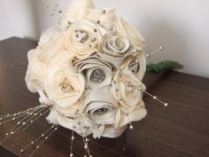 Stunning and unique posy made from beautiful vintage fabric, soft cream felt and assorted vintage buttons and brooches. A truly stunning alternative to a bouquet for a vintage style loving bride and/or her bridesmaids that lasts forever. Made to order from £25