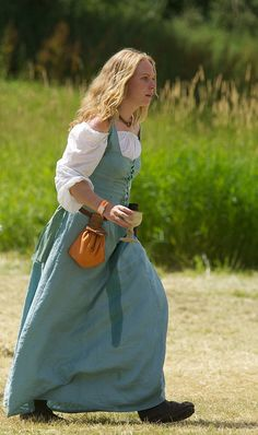 Reenactor (gathered off-shoulder underdress??) -- follow link to Tewkesbury Medieval Festival, 14th & 15th c, and Flickr gallery.