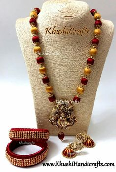 Maroon yellow silk thread neckpiece complimented with Lakshmi pendant... An ethnic piece sure to accentuate any attire...