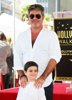 "Simon Cowell's son, doesn't know he's famous""-US Magazine, April 22, 2019. Good, for them! ""Simon Cowell and Eric Cowell attend the ceremony honoring Simon Cowell with a Star on The Hollywood Walk of Fame held on August 22, 2018 in Hollywood, California."" JB Lacroix/WireImage"