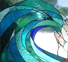 Stained glass wave by Mary Tantillo of SwellColors Glass Studio. (I did a piece along the same lines not too long ago, but she did it way better than I did! I've got a long way to go....)