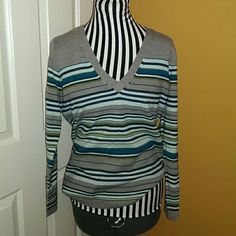 Grey striped sweater Fall is around the corner! Comfy grey v neck sweater with teal and turquoise stripes. Size M. 100% acrylic. New York & Company Sweaters
