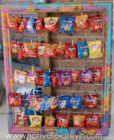 DIY Chip Bag Display - Paint an empty wooden frame. Staple twine to the back of frame. Add clothespin and chips.