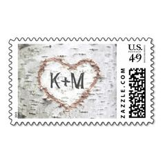 rustic birch tree postage stamps with carved love heart and bride and groom's initials.