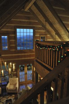 Loft area with festive heavy timber railing