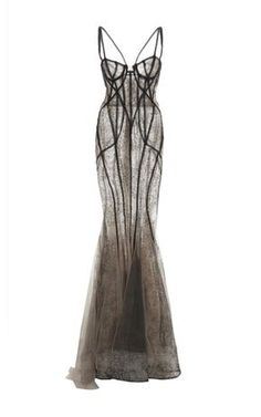 This chantilly lace **Marchesa** gown features a bugle beaded corset and a fishtail skirt with tulle inserts at the hem. jαɢlαdy