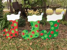 Christmas yard art, stockings yard art, Christmas decorations, Christmas yard decor, Christmas yard art by samthecrafter on Etsy Whoville Christmas, Christmas Train, Christmas Wood, Christmas Crafts, Christmas Ornaments, Christmas Lights, Christmas Ideas, Diy Christmas Yard Art, Yard Ornaments