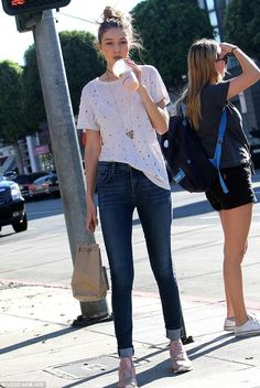 Gigi Hadid wearing AGOLDE Sophie Skinny Jeans in Soleil, IRO Clay Shirt, Reebok Classic Leather Pearlized Sneakers in Rose Gold, Jacquie Aiche Diamond Elizabeth Taylor Necklace, Jacquie Aiche 10 Eye Pyrite Choker, Jacquie Aiche Labradorite Honey Comb Necklace and Jacquie Aiche 10 Diamond Drop Earrings