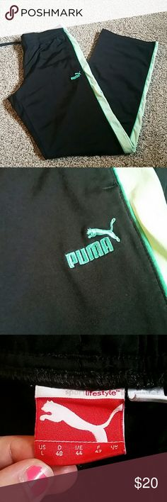 PUMA WOMANS DRAWSTRING PANTS Comfy puma drawstring pants with green down the sides with PUMA written on the front hip. And a puma on the back hip.  Excellent condition!  Size woman's large. Puma Pants Track Pants & Joggers