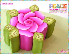 how to ake a fimo rose cane  Pink Rose Millefiori Cane by Ronit golan, via Flickr