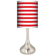 As bright and festive as a candy cane, the Red Horizontal Stripe giclee print shade infuses this contemporary brushed steel table lamp with holiday fun.