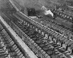 A steam train chugs through densely-packed housing Kensal Rise, west London in March 1921.