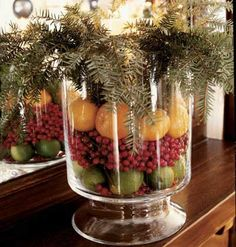 Fresh Fruit ~ Fill a bowl with colorful fruits and berries, and then top it off with evergreen cuttings. We used limes, non-poisonous nandina berry, and Clementine oranges. At the first sign of over-ripening, slice the fruit and place it outside to feed the birds.