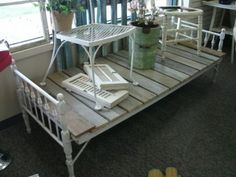 the old bed with sanded down boards from a pallet would be perfect outside with some big comfy outside pillows! LOVE