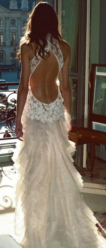 Im way not brave enough to wear something like this (although my back fat would love the breathing room), but I still think this wedding dress is gorgeous!