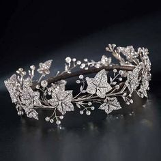 Diamond tiara, by Garrard & Co, with detachable ivy leaves that can be worn as a brooch, circa 1900. #VintageJewelry #Tiaras
