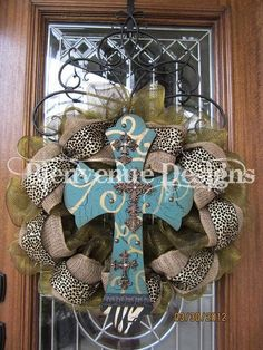 Love! Love! Love! Cross wreath with burlap, animal print, & a touch of color... This is cute!!