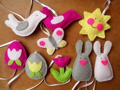 Reserved listing.  This Easter/Spring decoration set contains 27 soft, handmade ornaments (eggs, bunnies, smiling suns, butterflies, birds and flowers). Their average size is 6 cm (2,5 inches) plus hanger. Every item is handmade of acril blend felt and stuffed with syntetic material equiped with satin ribbon hangers.  Ready for shipping. Note: Colors can be slightly different on your screen.