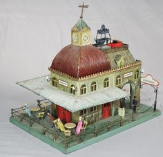 Circa-1905 Marklin 'Café' train  station with many papier-mache figures, ex Ward Kimball collection, tin, pristine and bright condition,
