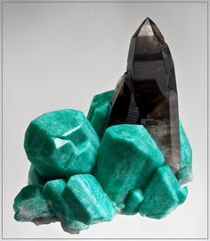 Amazonite & Smoky Quartz.  Amazonite is one of my favorites. Some wonderful specimens have been mined in Colorado.