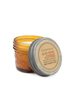 Soy wax paired with Blood Orange & Citrus fragrance notes hand-poured in an 3 oz. orange glass jar. Citrus Candle by Paddywax. Home & Gifts - Gifts New York City