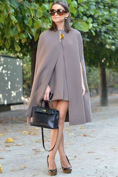 Miroslava Duma, Lanvin Cape and dress & Hermes bag, Paris Fashion Week Spring 2012