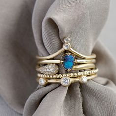 The Calypso Stack captured our hearts with a watery mix of diamonds, opals and textures. We can see ourselves basking in the Grecian sun wearing this effortless stack while we sip a sweet cocktail, can't you?