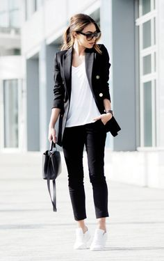 A black trouser suit worn with a plain white tee is another way to capture a…