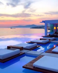 Cavo Tagoo Mykonos in Mikonos, Greece. High-end hotel offering upscale quarters, sophisticated dining & a chic spa, plus an infinity pool. Vacation Places, Vacation Destinations, Dream Vacations, Vacation Spots, Cavo Tagoo Mykonos, Greece Hotels, Paradise Travel, Mykonos Greece, Crete Greece