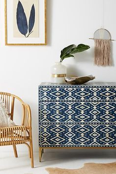 Anthropologie Ikat Inlay Three-Drawer Dresser. Perched atop the thin brass frame of this contemporary piece, modern ikat inlay aligns against a rich, indigo backdrop. Our furniture specialists are at the ready to help you find the right fit for your lifestyle and needs. Affiliate. #ContemporaryDecor