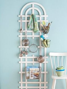 Simple and whimsical storage for your kitchen. This kitchen trellis can hold any sort of things you'd like; just add pegboard hooks, baskets, and small shelves.