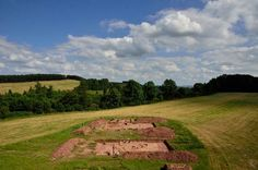 "Archaeologists have unearthed two nearly 6,000-year-old burial mounds and the remains of two massive buildings in England.   The two wooden long-buildings, or halls, were burnt to the ground; the ashes were then shoveled in to make burial mounds.  ""The buildings seemed to have been deliberately burned down,"" said Julian Thomas, the archaeologist leading the excavation and a professor at the University of Manchester."
