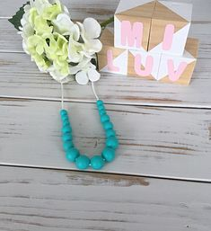 This  nursing necklace will keep your little one entertained for hours- a great distraction for those restless, inquisitive and curious babies while feeding!  This necklace is made from 100% food-grade silicone beads. The necklace is complete with a strong 60cm satin nylon cord and features a safety breakaway clasp, designed to pop open when pulled and tugged on. With a variety of textures, colours and materials bubs will sure love this necklace on his Mamma! Nursing Necklace, Teething, Food Grade, Cord, Arrow Necklace, Safety, Satin, Strong, Necklaces