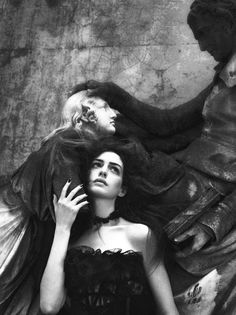Darkly Romantic – Mert & Marcus transforms actress Anne Hathaway into a gothic heroine for the September cover shoot of Interview Magazine. Styled by Karl Templer in romantic gowns and dresses from the likes of Nina Ricci, Gucci, Dolce & Gabbana and Tom Ford; Anne gives a riveting performance in the dramatic black and white series.