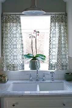 Cute kitchen curtain style (different pattern needed but the style curtain softens the window)
