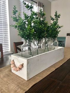 Mason jar wood caddy. Wood bead handles. Boxwood leaves. Centerpiece. Kitchen table decor