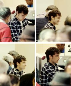 Josh in LAX airport he is so adorable! look at that smile and messy hair ahaha