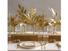 Unique wedding centerpiece idea with metallic gold and wood accents.  www.agoodaffair.com/blog