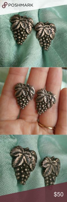 Vintage sterling silver Grapes earrings screwback This beautiful pair of vintage earrings is shaped like bunches of grapes! They are made of solid .925 sterling silver and are excellent quality. They have screwbacks for non pierced ears. Signed STERLING on the backs. Grapes are in excellent condition with darkened age patina which I will not polish off. From a smoke free home :)  MAUSG8388GRAPES888 Vintage Jewelry Earrings