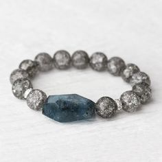Made with beads/stone/crystal from the market places of his kingdom. Comprised of raw aetheryte as well.  Kyanite Crystal Bead Bracelet