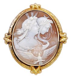 Antique Cameo and 18K Gold Brooch, circa 1870  Centering an oval shell cameo depicting the allegory of day and night, height 2 3/4 ins, width 2 1/2 ins, with box stamped Shortt, Hill & Duncan Limited, Diamond Marchants, Victoria, B.C.
