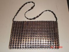 A purse with pop tabs