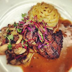 6oz Grilled Petite Filet with Applewood Smoked Bacon and Wild Mushrooms, Parmesan Mashed Potatoes with Cognac Peppercorn Cream
