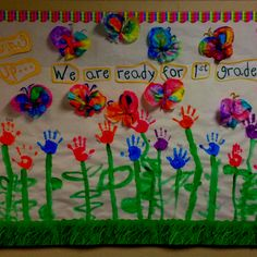 End of year kindergarten bulletin board. Hand print flowers. I used 2 coffee filters for butterfly wings. Color filters with markers and spritz with water so the colors bleed.