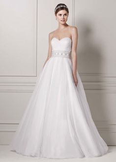 Strapless tulle ball gown with beaded belt, natural waist, sweetheart neckline. Style #7CPK440