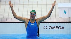 15 year old Ruta Meilutyte of Lithuania celebrates after winning the final of the women's 100m Breaststroke.