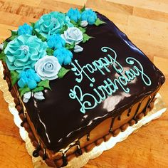 Buttercream flowers on a chocolate drip cake