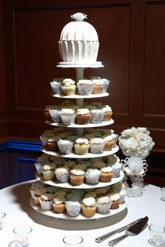 Five tier cupcake stand with an antique ceramic cupcake topper | One Fine Day Photography | villasiena.cc