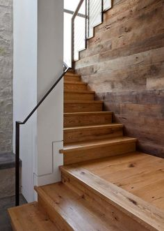 A wood staircase with metal railing is the way to go for something industrial