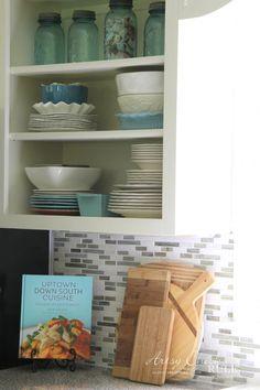 Coastal Inspired DIY Tile Backsplash Tutorial (anyone can do! Diy Tile Backsplash, Vinyl Wood Planks, Down South, It's Easy, Coastal, Bookcase, Artsy, Restaurant, Shelves